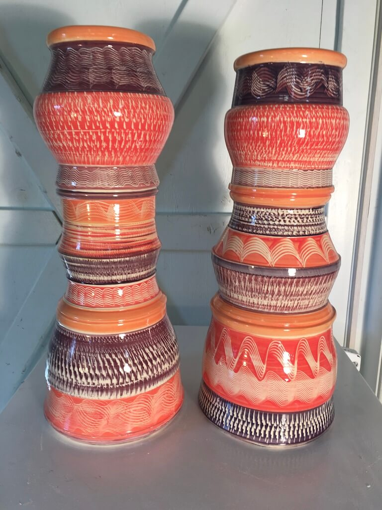 photo of tall decorative patio vases in salmon color